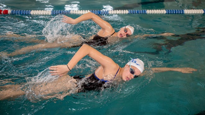 Swimming sisters Noelle, top, and Anna Peplowski of Germantown Hills swim together during a workout Dec. 23, 2019 at Five Points Washington.