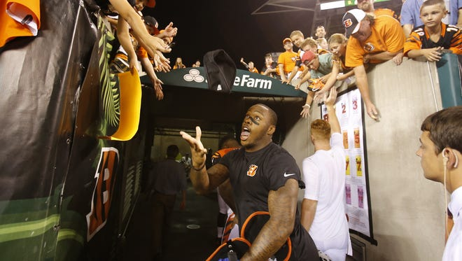 Bengals running back Jeremy Hill tosses a head band into the crowd after the game.