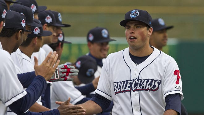 Damek Tomscha greets BlueClaws teammates during opening day of last season. Tomscha helped seal two wins for Lakewood in Monday's doubleheader when he hit a two-run double in the top of the eighth inning of the first game against Charleston, then an RBI single in the sixth inning of the second.