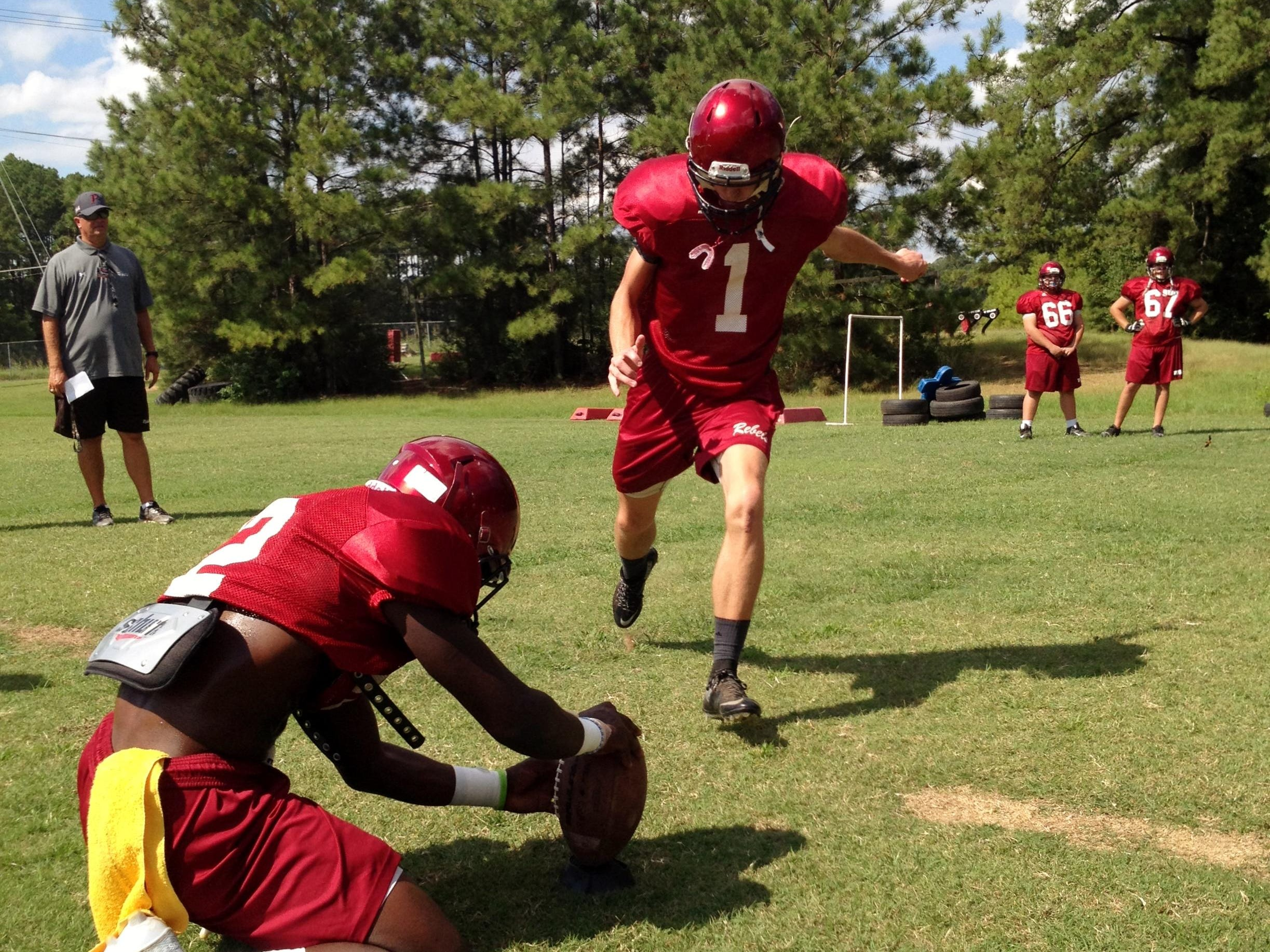 Pineville senior placekicker Gavin Capehart (1) attempts a field goal at practice on Tuesday. Capehart, a transfer from Alabama, is the latest in a long line of Rebels who played kicker and a skill position. Through two games, Capehart has made five PATs and has one reception for 35 yards.