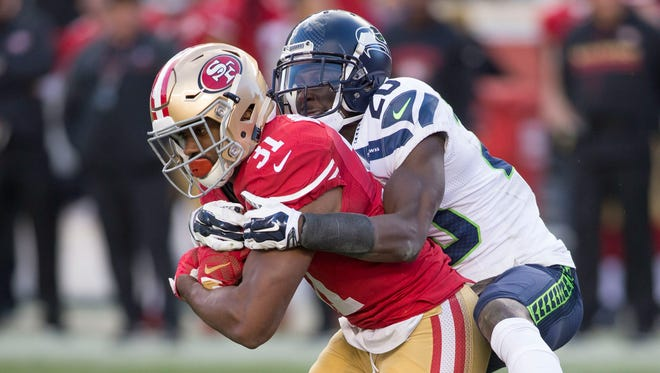 Seahawks cornerback Jeremy Lane, right,  tackling San Francisco running back Raheem Mostert in the regular-season finale, is among the Seahawks players who didn't participate in the NFL combine.   (31) during the third quarter at Levis Stadium Seahawks defeated the 49ers 25-23. Mandatory Credit: Neville E. Guard-USA TODAY Sports