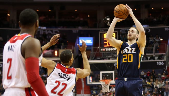 Utah Jazz forward Gordon Hayward shoots the ball as Washington Wizards forward Otto Porter Jr. defends.
