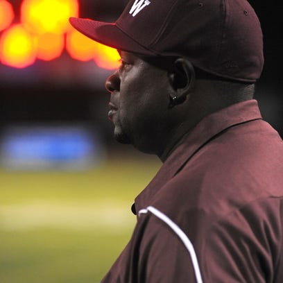 BTW coach Kendrick Law watches the action.