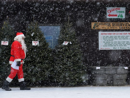 Santa Claus walks by the office at Riverview Christmas Tree Farm near Canton in 2011.