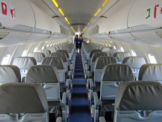 The interior of an Elite Airways Bombardier CRJ.