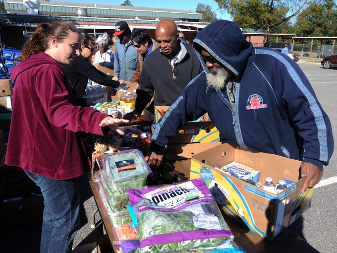 Herman Pleasant picks up free food donated by Bay Area