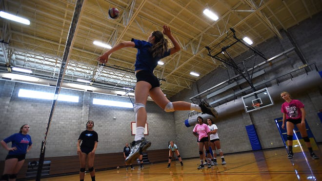 Sophomore Parker Buddy goes up for a spike during a team volleyball practice at Reno High School on Tuesday.