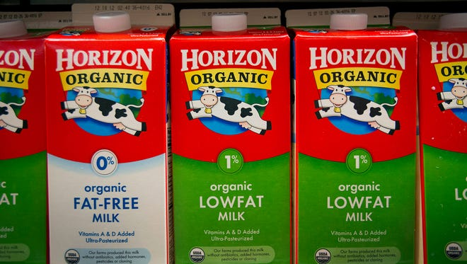 Cartons of WhiteWave Foods Co. Horizon Organic milk, a unit of Dean Foods Co., are displayed for sale at a supermarket in New York, U.S., on Monday, Nov. 5, 2012. Dean Foods Co. is scheduled to release earnings data on Nov. 8. Photographer: Scott Eells/Bloomberg ORG XMIT: 136461264