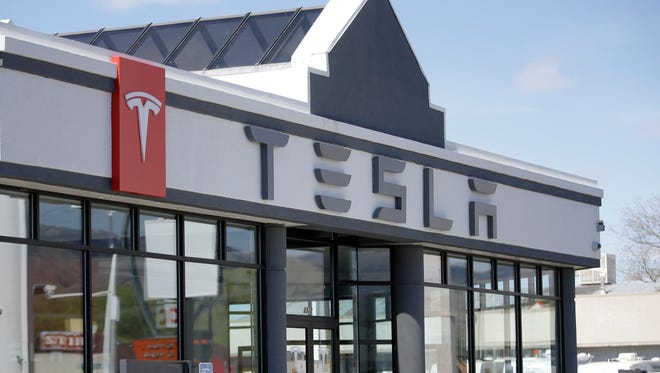 This April 1, 2015, file photo shows the Tesla Motors new showroom in Salt Lake City. New car dealers in Utah are fighting back against Tesla's Utah Supreme Court push to sell its sleek electronic cars in Utah, arguing that state laws were set up to protect customers and Tesla should have to follow them like everyone else.