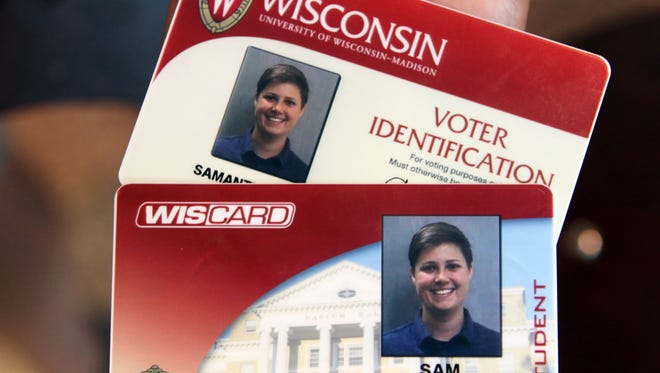 Sam VanWees from Des Plaines, Ill., says she was not aware she is eligible to vote in Wisconsin. She got her free voter ID card at Union South on the University of Wisconsin-Madison campus, along with her regular Wiscard student ID, on Aug. 30, 2016.