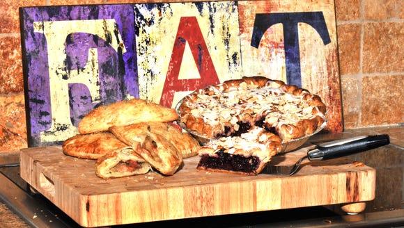 Acadian Slice's cherry pie and apple-bacon hand pies.