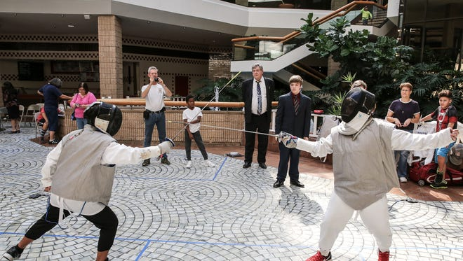 Sam Straub, 8 (left), competes against Benton Bresler, 11, during their foil fencing matchup during the Coastal Bend Fencing Society mini-tournament Saturday, Oct. 29, 2016, at Sunrise Mall. Foil fencing only allows for points to be scored on hits to specific areas of the upper body.
