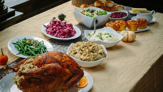 Each and every item needs to stand out when setting a Thanksgiving table. (Place settings are by Mansions on Fifth; linens are from Mosaic; and food is by Settlers Ridge Giant Eagle Market District.) (Andrew Rush/Pittsburgh Post-Gazette/TNS)
