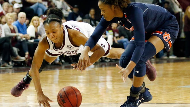 Mississippi State guard Morgan William (2) dives for loose ball in front of Auburn guard Erica Sanders (3) during the first half of an NCAA college basketball game in Starkville, Miss., Thursday, Feb. 22, 2018. (AP Photo/Rogelio V. Solis)