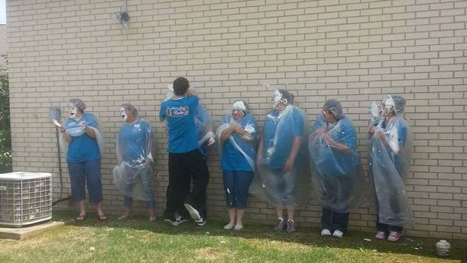 The staff of Twin Lakes Therapy and Living gets pies in the face from employees to bring National Nursing Home Week to a close. The week was filled with events, including a small car show by Ed Finley, Bo Muzzi, Greg and Beth Watts, Charlie and Sue Smith, Jim Williams, Charlie Martin, Jerry Hopper and Greg Hopper.