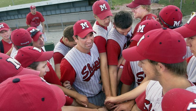 Head coach Bruce Steinbecker, center, returns to lead an offensive-minded Manitowoc Lincoln baseball  squad in the 2016 season.
