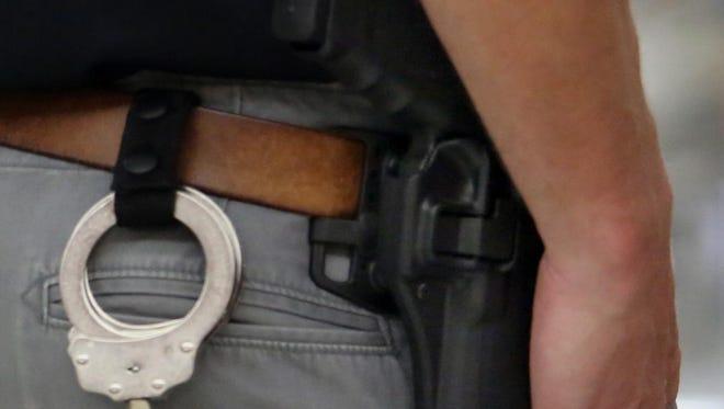 Marshfield Police liaison officer Jason Foemmel wears a gun while on duty May 28 at Marshfield High School.