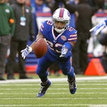 Bills safety Bacarri Rambo (30) returns the first of his two interceptions against the Packers.
