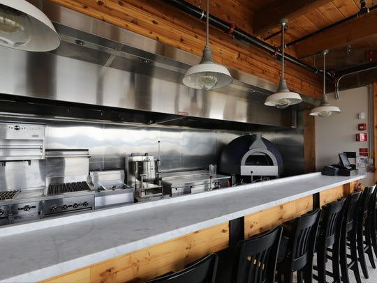 The interior exposed kitchen at Hudson Farmer & the