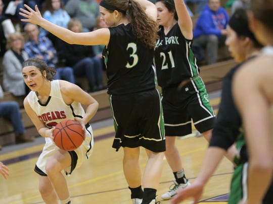Crestview's Anna Stimpert looks for an opening to shoot a basket while playing against Clear Fork during sectionals at Lexington High School on Wednesday.