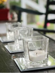 Use small 4-inch-by-4-inch square mirrors under candles inside or outside your home. It will reflect the candlelight beautifully.