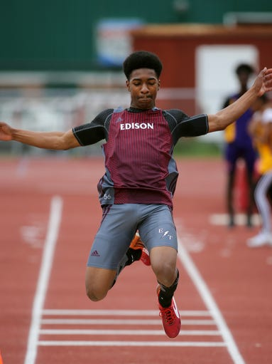Edison's Zion Ponder competes in the long jump.