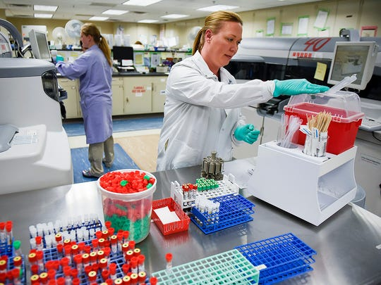 Jody Staples, medical laboratory scientist, has recycle bins around lab and at work stations at work stations Thursday, June 8, at the St. Cloud VA Health Care System.