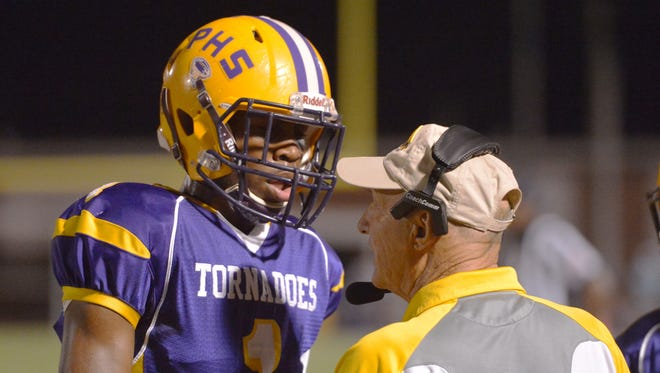Purvis coach Perry Wheat, right, goes over a play with a player Friday against Moss Point.
