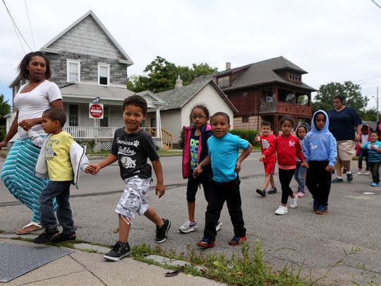 Tiffany Archibald leads her Pre-K summer program at Ibero Family Center to the library on Joseph Avenue. The summer learning program that targets Rochester City School District students was expanded to Pre-K this year with grant funding.