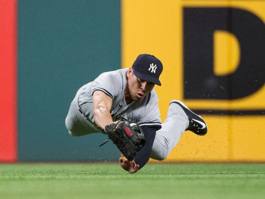 New York Yankees' Jacoby Ellsbury makes a diving catch