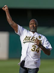 In this July 19, 2014, file photo, former Oakland A's pitcher Dave Stewart throws out the ceremonial first pitch. Stewart is in Nashville this week and attending Vanderbilt's game against Florida.