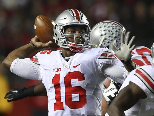 Ohio State quarterback J.T. Barrett (16) throws a pass