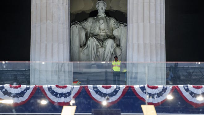 A spotlight is tested on the statue of President Abraham Lincoln as Fourth of July festivities are set up at the Lincoln Memorial, Wednesday, July 3, 2019, in Washington.