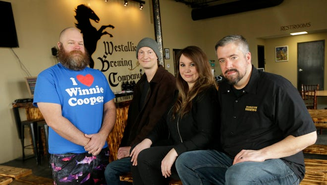 Neal Steffek (from left), ) owner the Drunk Uncle bar in West Allis, Timothy Szuta, owner of Alphonso's The Original pizza place in West Allis, and Kimberly and Erik Dorfner, owners of Westallion Brewing Co. in West Allis, held a joint fundraiser last weekend at Westallion Brewing to raise money they hope will offset budget cuts of art and music in West Allis schools.