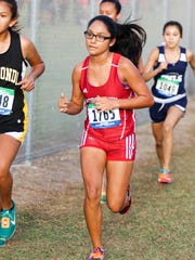 Robstown's Cindy Sanchez (center) competes at the Region IV-4A Cross-Country Meet on Saturday, October 29th at the Dr. Jack A. Dugan Stadium in Corpus Christi. Sanchez qualified for state after missing out as a sophomore and junior.