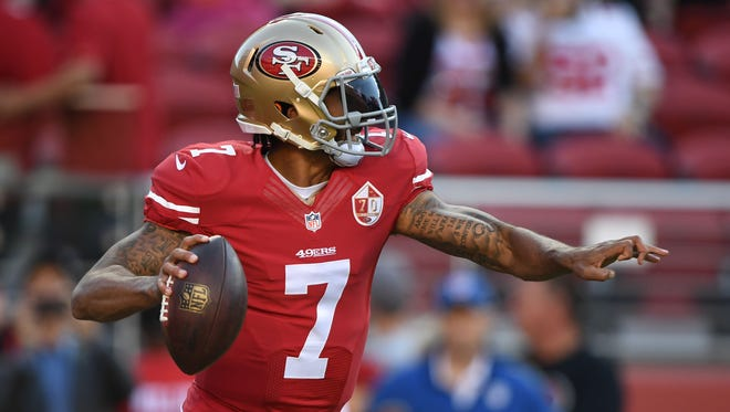 Colin Kaepernick warms up before the game against the Packers last Friday.