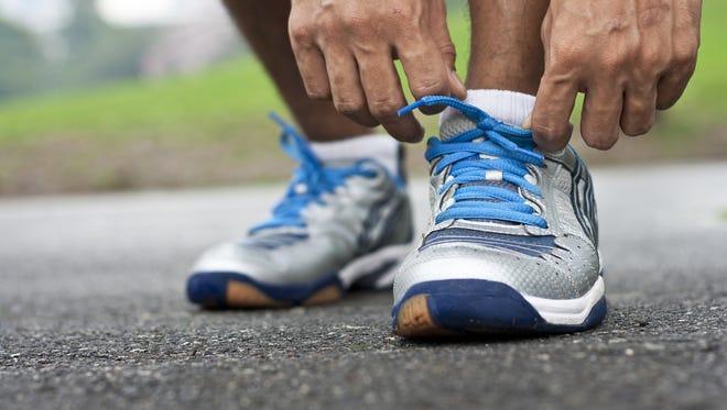 Athlete tying running shoes
