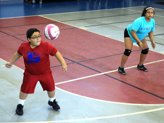 Christian Garza (left), 10, and Milla Arredondo, 13, participate in a Corpus Christi Parks and Recreation volleyball camp at the Corpus Christi Gym on Thursday, June 29, 2017. In addition to learning basic skills, students learn to work as a team.