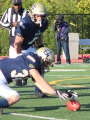 Senior linebacker Connor Coffman (32) recovers a fumble in DCD's victory over Bradford Academy.