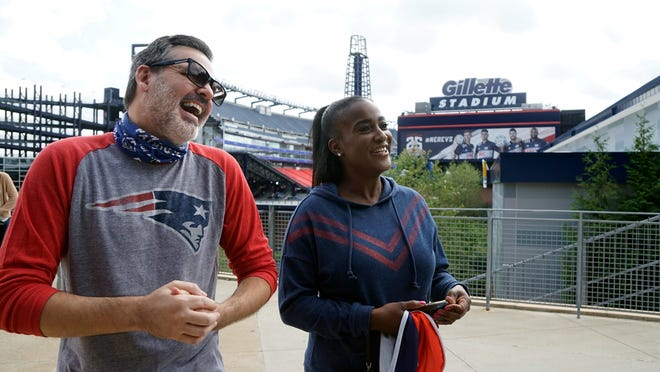 Friends and season ticket holders Mike Rodrique of N.H. and Clucia Fowlkes came to take in the atmosphere of the Patriots' opening day.