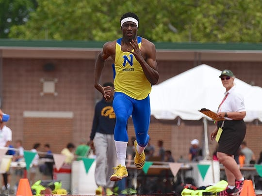 Northwest's Malik Beverly competes in the long jump at the Division I state meet June 4 at Ohio State's Jesse Owens Memorial Stadium.