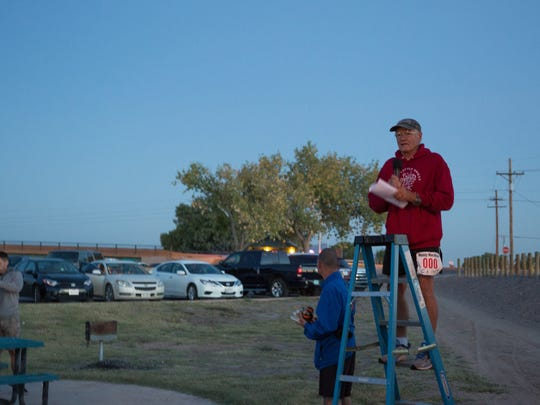 Clint Burleson, talks to the group of runners gathered to run the first day of the Day of the Dead Marathon Series, Saturday, October 29, 2016. His company, Mainly Marathons, organized the series in 2012 and has since expanded to organize 65 races across 49 states.