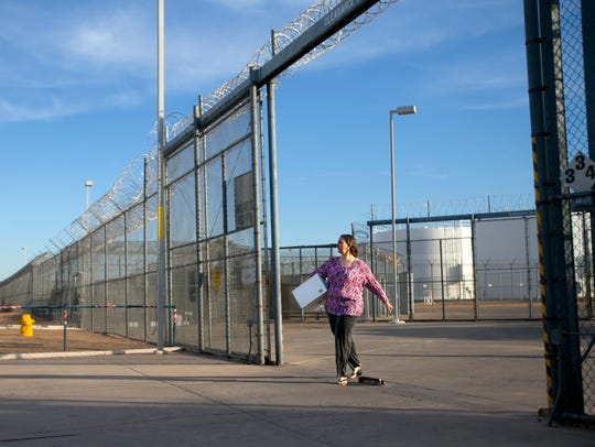 After serving her sentence, an inmate walks out of