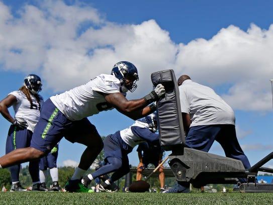 Seattle Seahawks defensive end Shaneil Jenkins hits