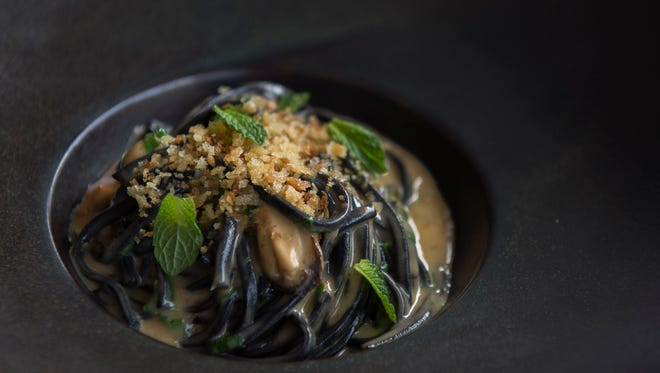 Squid Ink alla Chitara from A Mano in Philadelphia is a dish of long ebony noodles, plush mussels in a lagoon of butter, lemon and melted uni, golden breadcrumbs and mint for freshness and a tad of red chili.