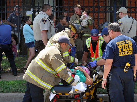 Emergency medical personnel tend to several children injured in a two-vehicle accident Thursday afternoon at Harrison and the Kell West frontage road.