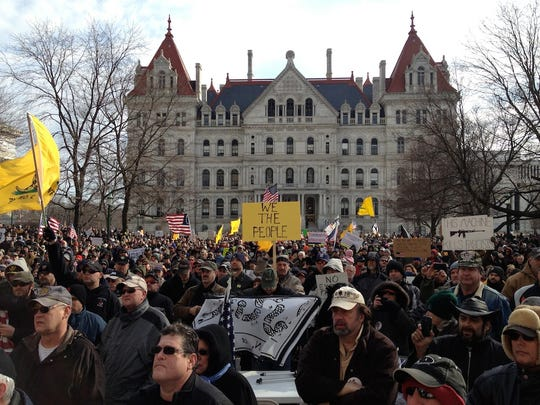 Rallies were held outside the state Capitol in 2013 after New York passed the SAFE Act, a gun-control law. Now the state Legislature is to pass a new round of laws.