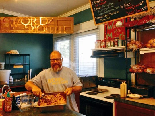 "Word of Mouth Café owner John Gunter prepares pulled pork for his Monday special pork tacos. The downtown Alexandria restaurant was ranked among 15 best ""cheap eats"" in America on an online list by TABElog."