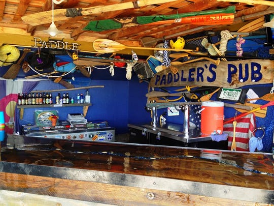 Paddler's Pub is an outdoor venue and bar space that acts as a rafting company headquarters during the day.