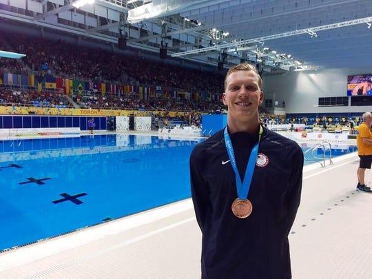 Max Williamson celebrates with his bronze medal in Toronto.